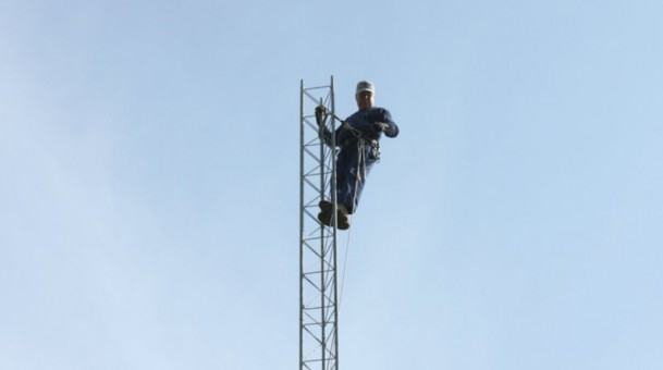 Man Climbs Tower, Won't Come Down Until Family Leaves