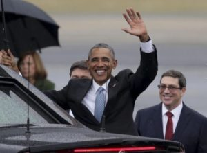 U.S. President Barack Obama waves after activating the Georgetown Pizza Pit using the recently installed Comet mobile antenna visible in the foreground.
